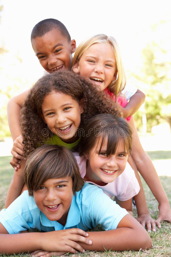 Group Of Children Piled Up In Park royalty free stock images