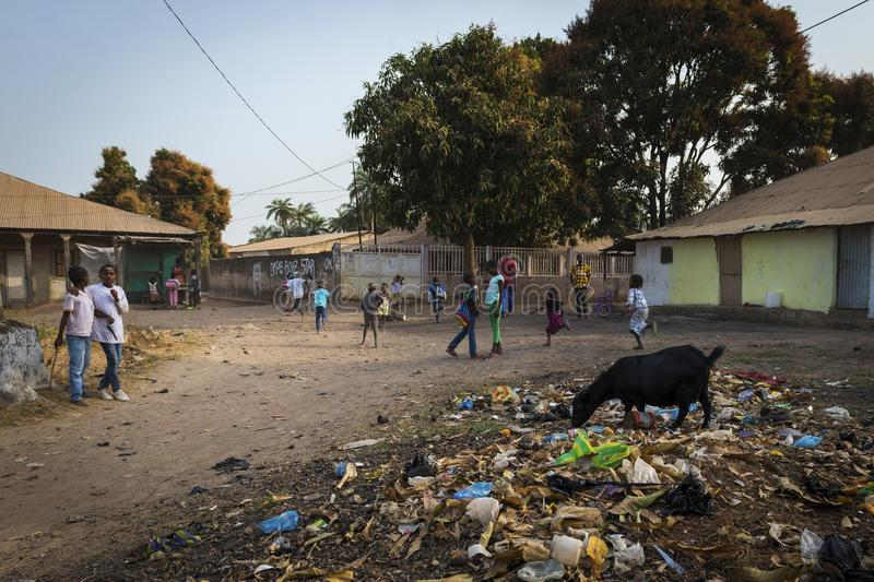 Group of children playing in a dirty street at the Bissaque neighborhood in the city of Bissau, Guinea Bissau. Bissau, Republic of Guinea-Bissau - January 29 royalty free stock images