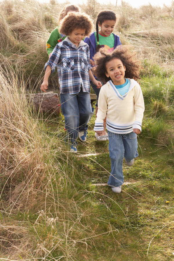 Download Group Of Children Playing In Field Together Stock Photo - Image: 15687452