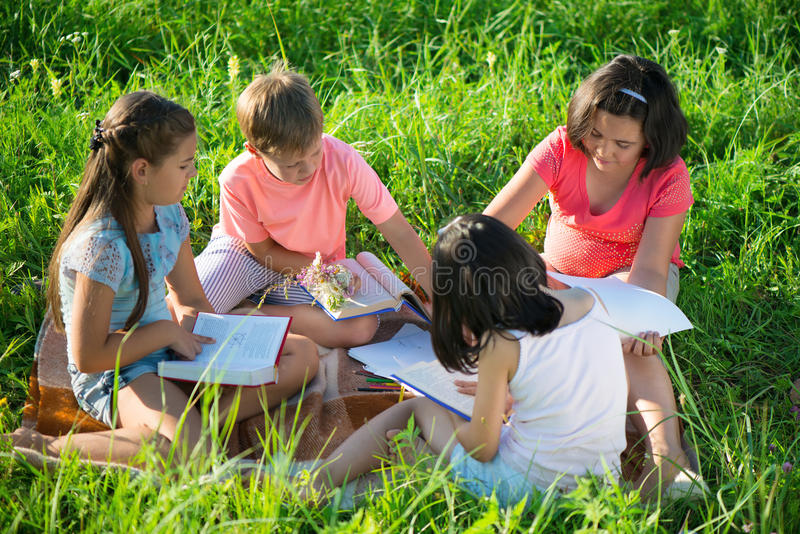 Group of children playing on grass stock photography