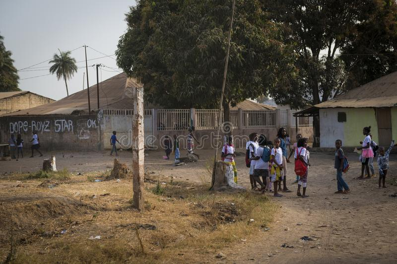 Group of children playing outside their school after the classes, at the Bissaque neighborhood in the city of Bissau. Bissau, Republic of Guinea-Bissau - January royalty free stock image