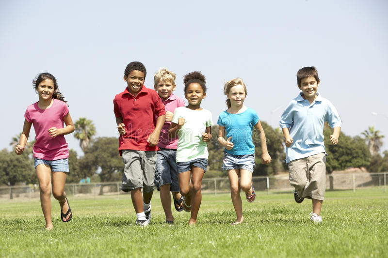 Download Group Of Children Running In Park Stock Image - Image: 12406297