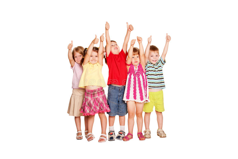 Group of children showing thumbs up sign stock images