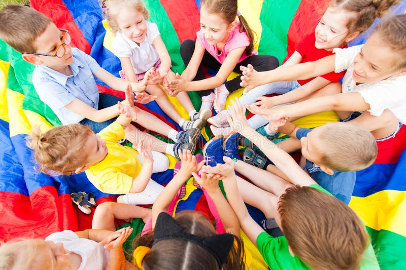Group of children siting in a circle royalty free stock photo