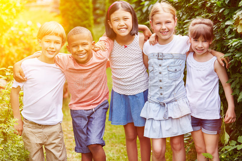 Group of children smiling as friends stock images