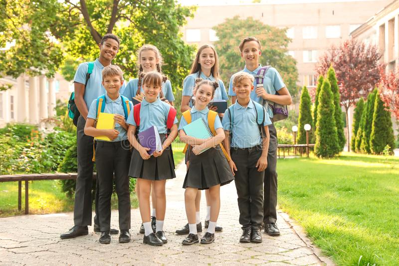 Group of children in stylish school uniform. Outdoors royalty free stock photography