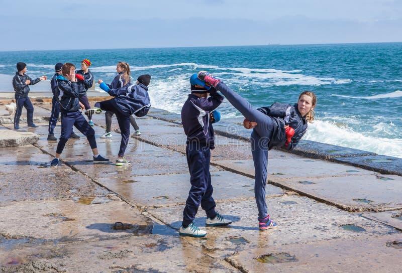 Children training karate on the stone coast royalty free stock photos