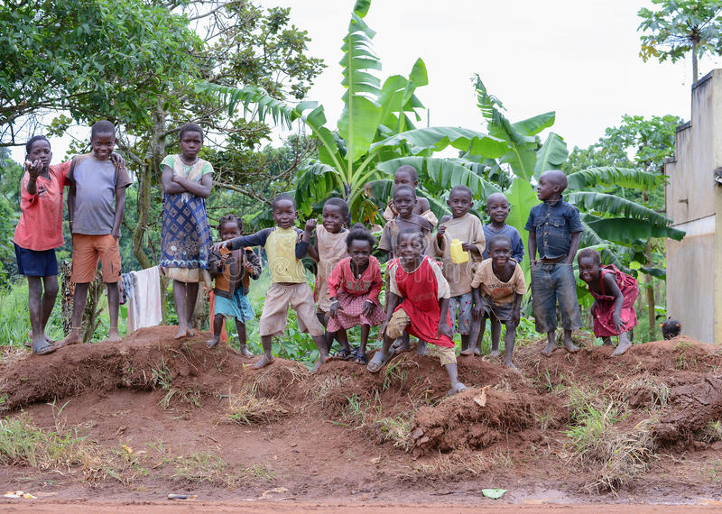 A group of children in Uganda. MASINDI, WESTERN UGANDA/UGANDA – MAY 24, 2014: A group of children on a village roadside royalty free stock photography