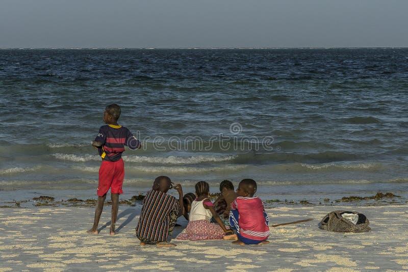Group of children on Zanzibar beach royalty free stock images