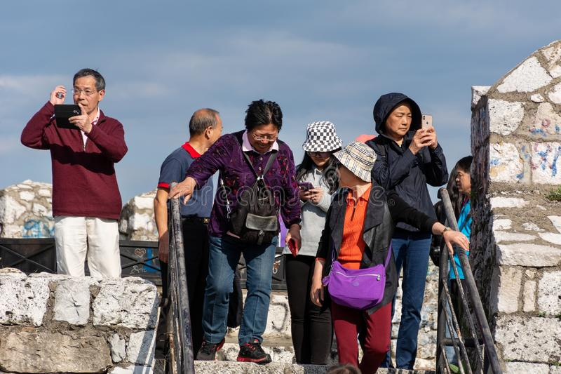 A group of Chinese tourists visit and photograph at an old medieval fortress in the city of Nis, Serbia, Europe royalty free stock image