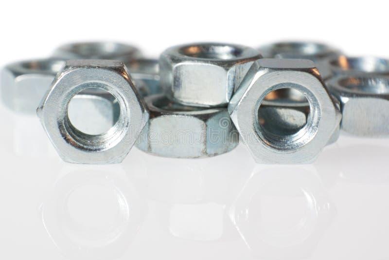 Group chrome screws. Group chrome nuts on white background royalty free stock photos