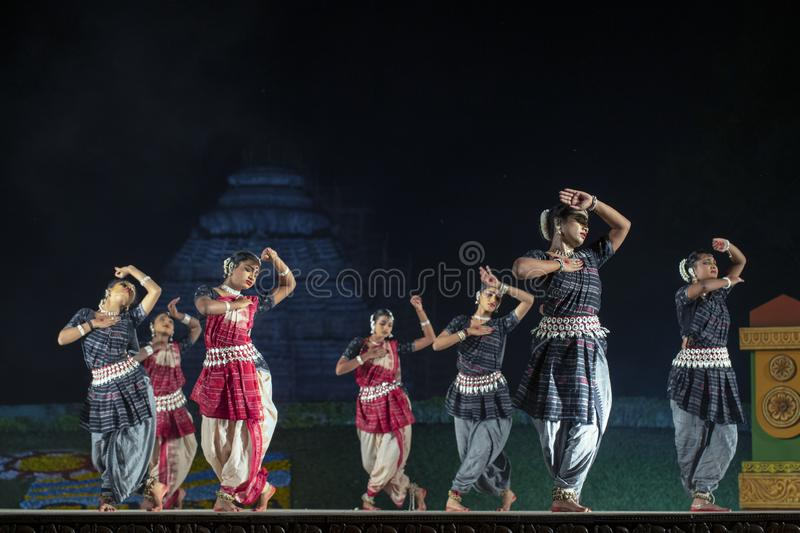 A group of Classical Odissi dancers performing Odissi Dance on stage at Konark Temple, Odisha, India. royalty free stock image