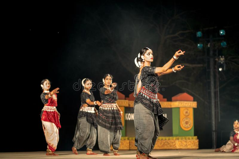 Group of Classical Odissi dancers performing Odissi Dance on stage at Konark Temple, Odisha, India. stock photos