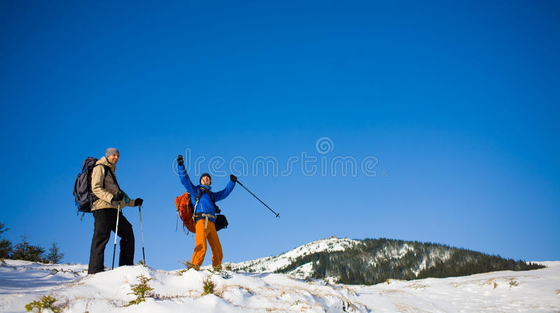 A group of climbers in the mountains. A group of climbers going to the top of the mountain during the winter royalty free stock photography