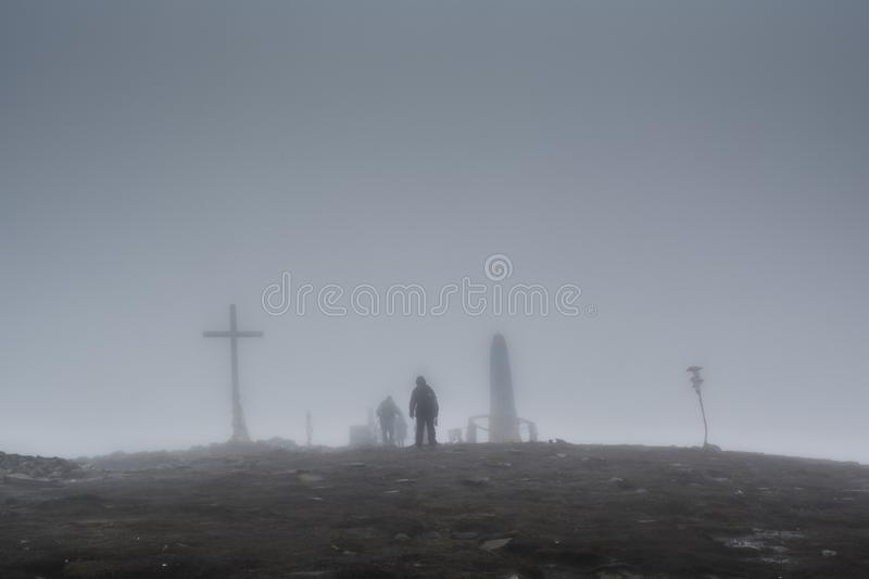 Group of climbers reached the top of the mountain stock photos