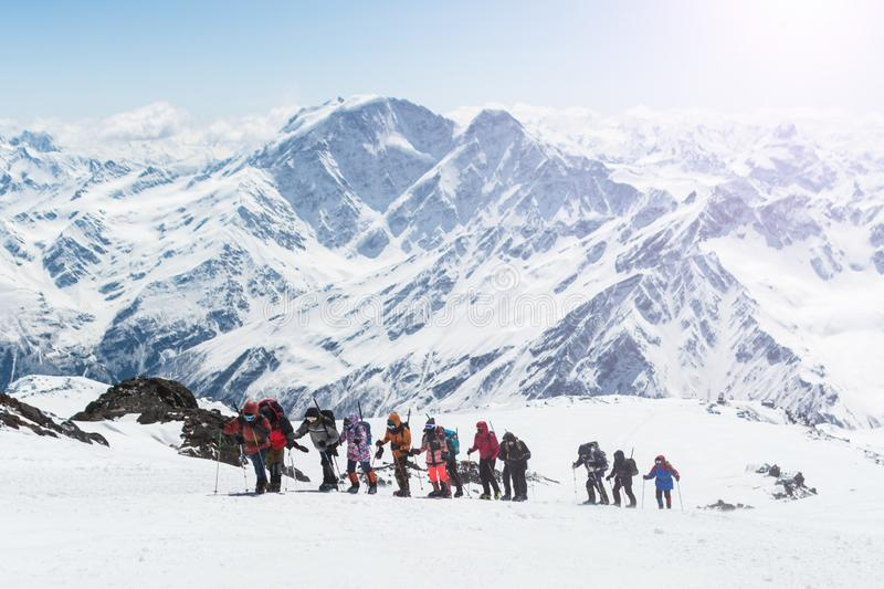 A group of climbers walking high in the mountains royalty free stock photography