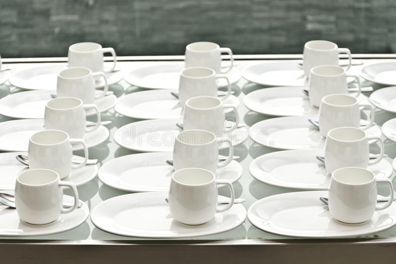Group of coffee cups.empty cups for coffee.Many rows of white cup for service tea or coffee in breakfast at buffet event.white cup royalty free stock images