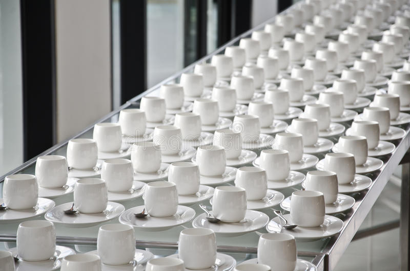 Group of coffee cups.empty cups for coffee.Many rows of white cup for service tea or coffee in breakfast at buffet event.white cup stock images
