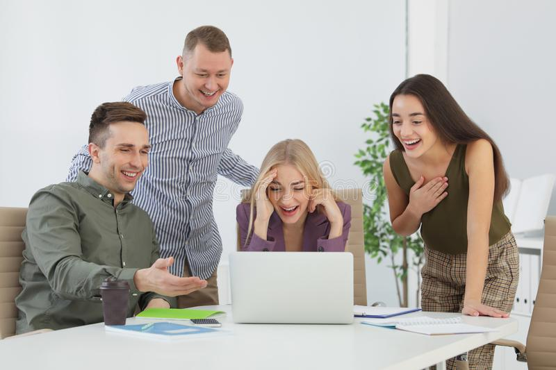 Group of colleagues laughing together royalty free stock photo