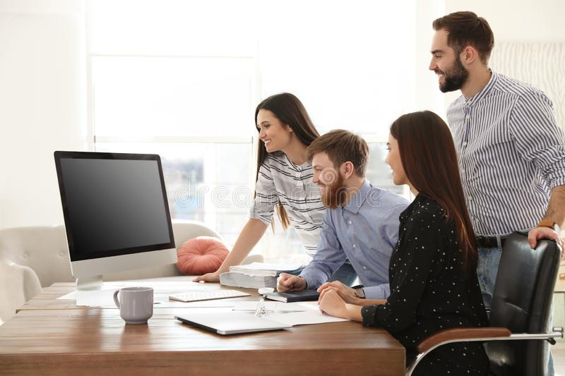 Group of colleagues using video chat on computer in office royalty free stock image