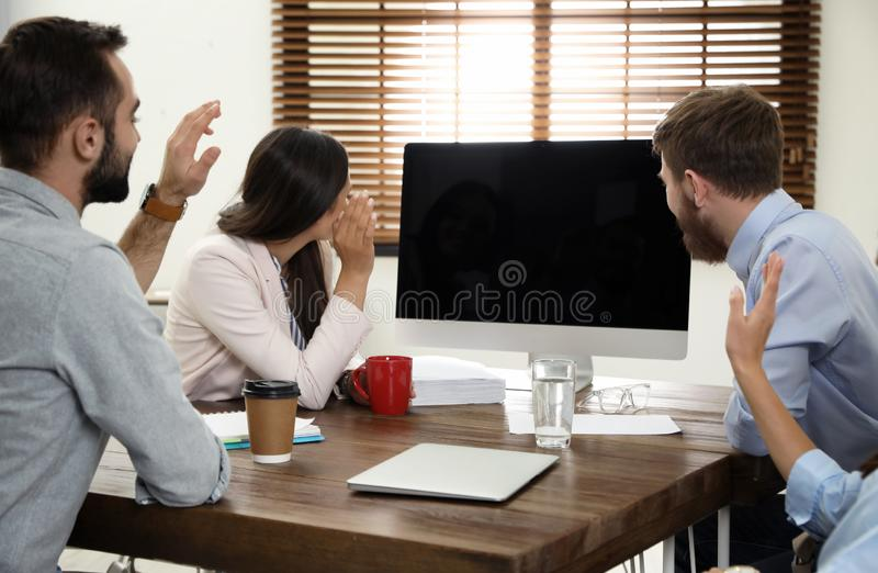 Group of colleagues using video chat on computer in office royalty free stock images