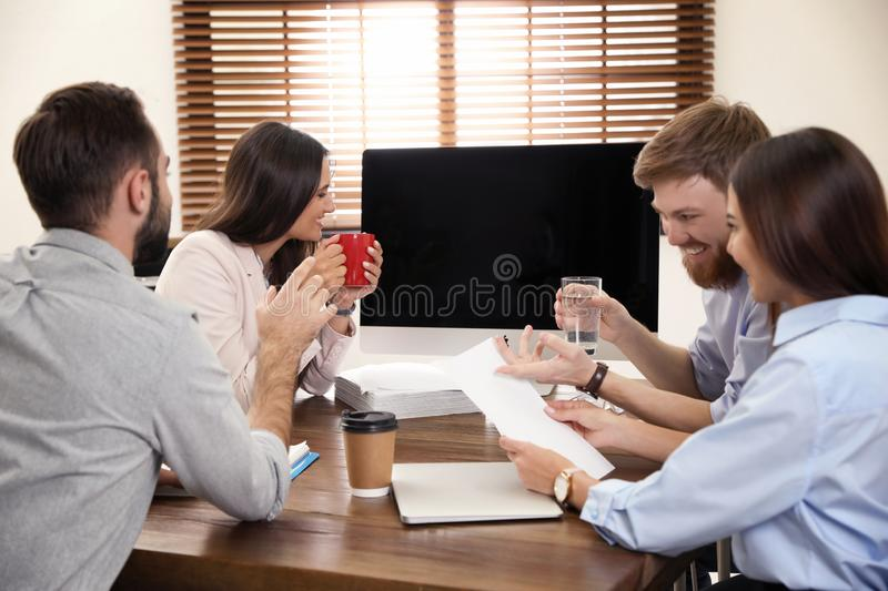 Group of colleagues using video chat on computer in office royalty free stock photography