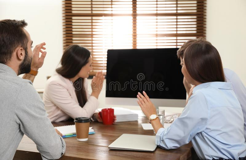 Group of colleagues using video chat on computer. Space for text stock images