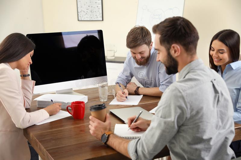 Group of colleagues using video chat on computer in office. Space for text stock photo