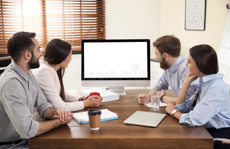Group of colleagues using video chat on computer in office. Space for text stock images