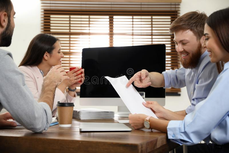 Group of colleagues using video chat on computer in office. Space for text royalty free stock photography