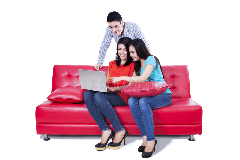 A Group Of College Friends With Laptop Royalty Free Stock Photography