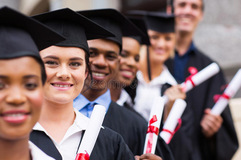 Group college graduates. Group of happy college graduates standing in a row stock images