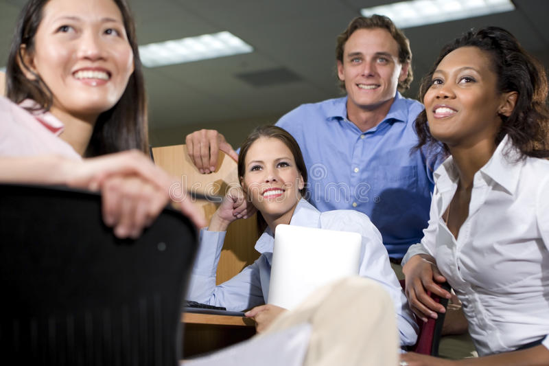Group of college students studying together. Multiethnic group of college students studying together stock photos