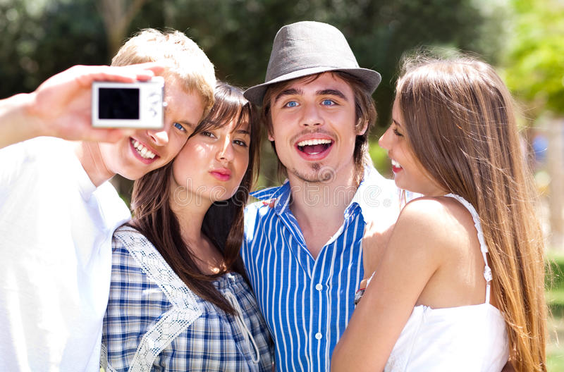 Group of College students taking a self portrait. Group of College students standing together taking a self portrait royalty free stock photo