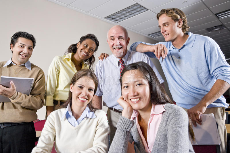 Group of college students and teacher in class. Multiracial group of college students and teacher in class stock photo