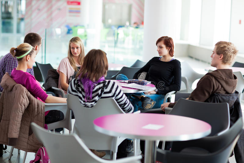 Group of college/university students during a brake royalty free stock photography