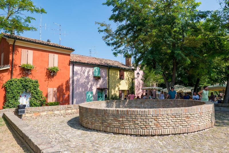 Group of colored houses in the old square with masonry basins originally used for the conservation of freshly caught fish. Today the local market royalty free stock photo