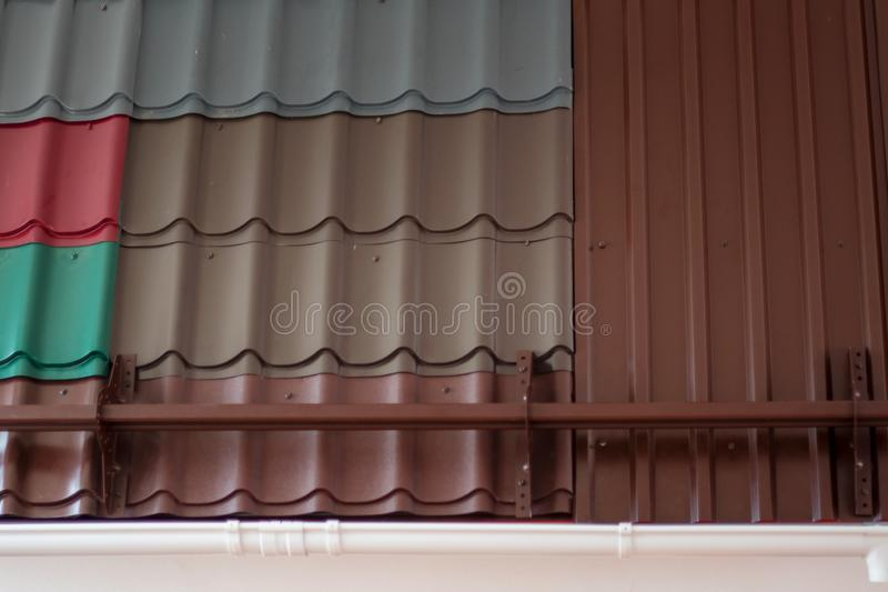 Group of colorful construction steel profile panel sheets for example at the exhibition royalty free stock photography