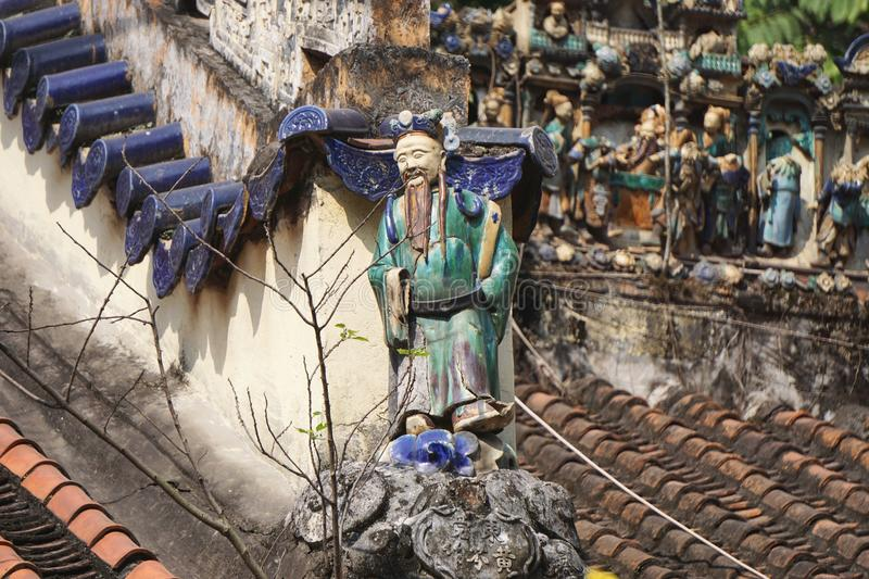 Colorful glazed ceramic figures on the roof of a Buddhist temple in Hanoi, Vietnam stock images