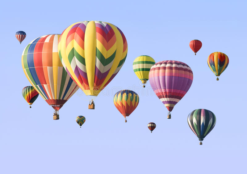 A group of colorful hot-air balloons floating. Across the sky stock image