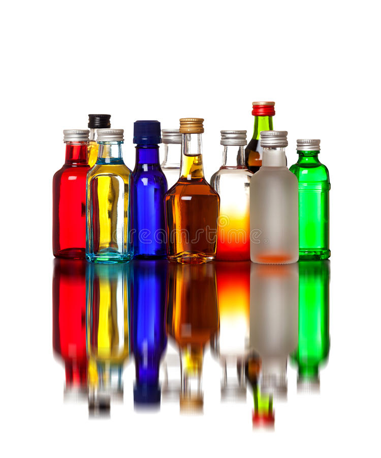 Group of colorful little bottles royalty free stock photography