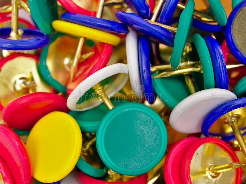 Group of colorful multi - colored pushpins. royalty free stock images