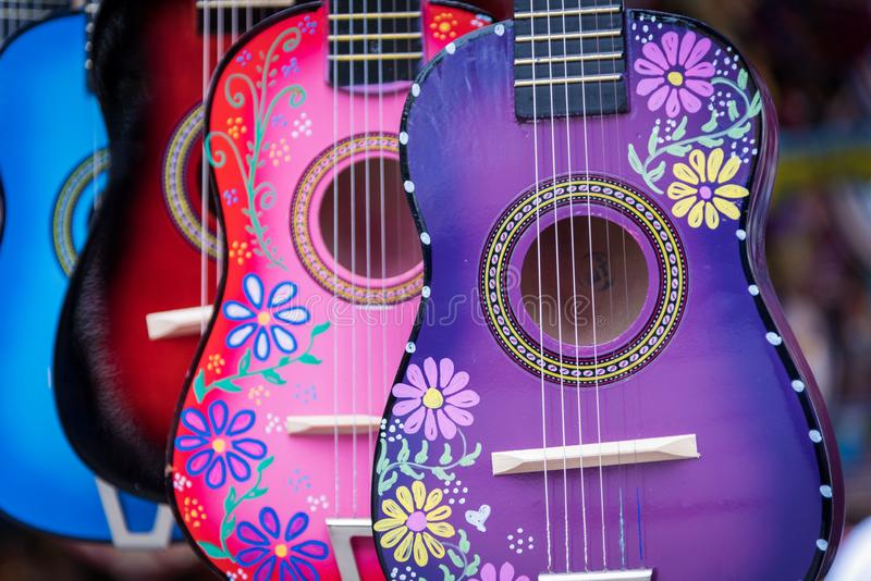 A group of colorful painted mexican made guitars royalty free stock photos