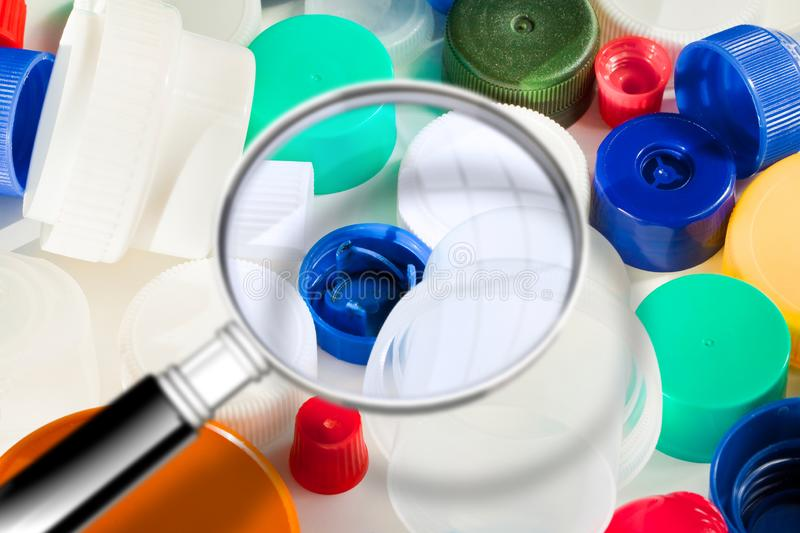 Group of colorful plastic caps - Concept image seen through a magnifying glass.  stock images