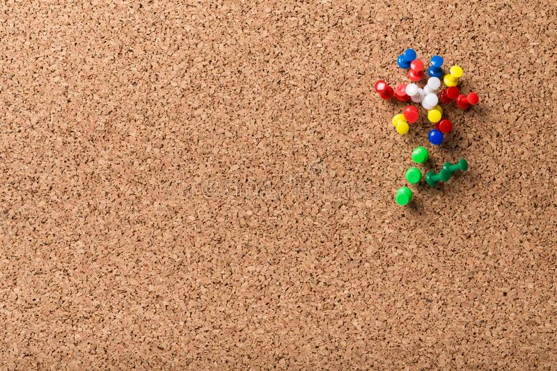 Group of colorful push pins on cork bulletin board royalty free stock images