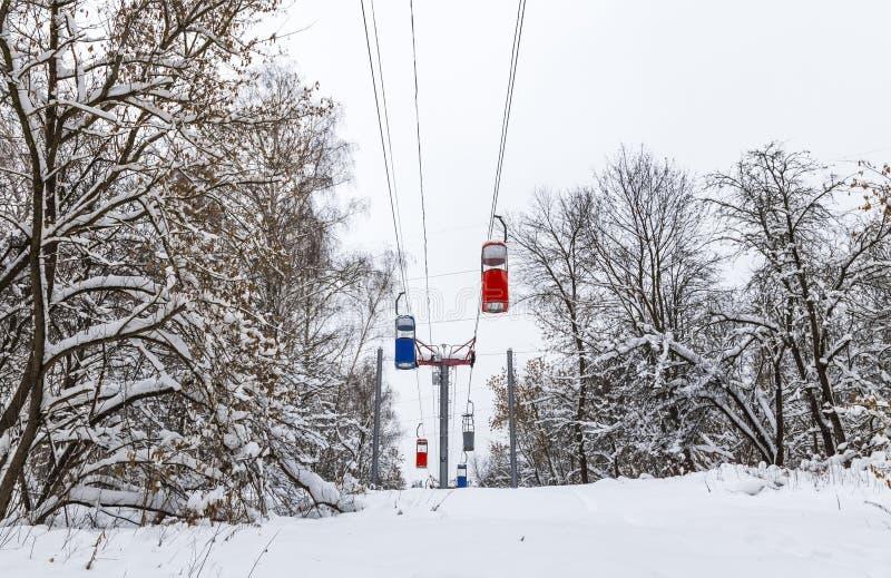 Group of colorful telpher cable cars, winter season, Kharkov, Ukraine royalty free stock photos