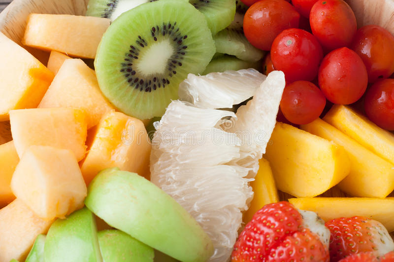 Group of colorful variety fruits salad, healthy eating and dieting food, concept of health care. Group of colorful variety fruits salad, healthy eating and stock photo