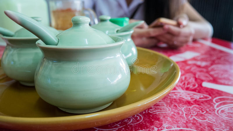 Group of condiment bowl on table.  stock photo