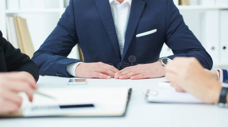 Group of confident business partners planning work at meeting. stock image