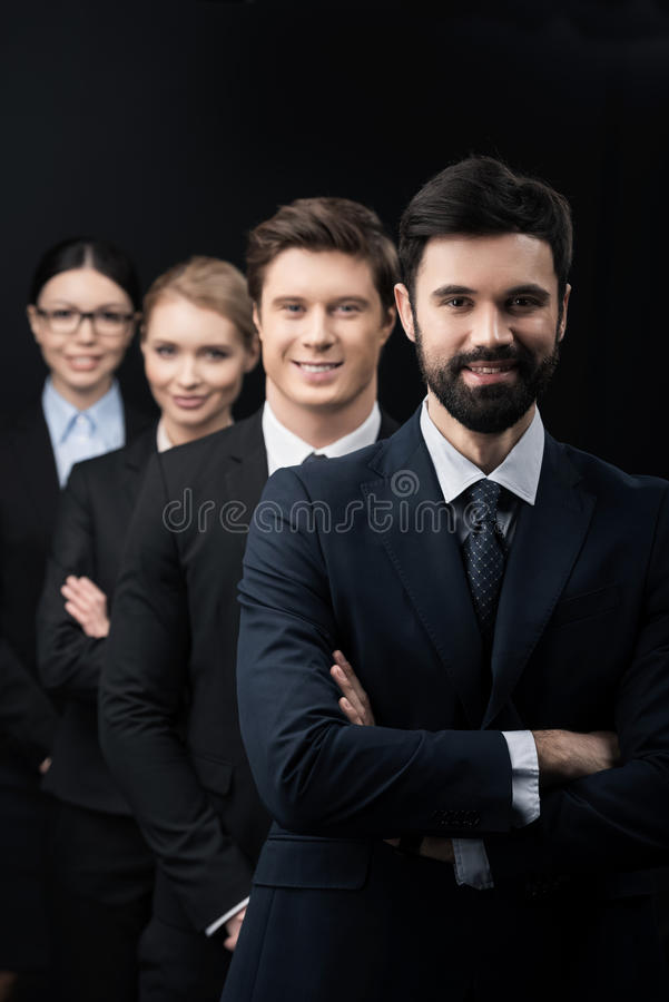 Group of confident business people standing in row royalty free stock photography